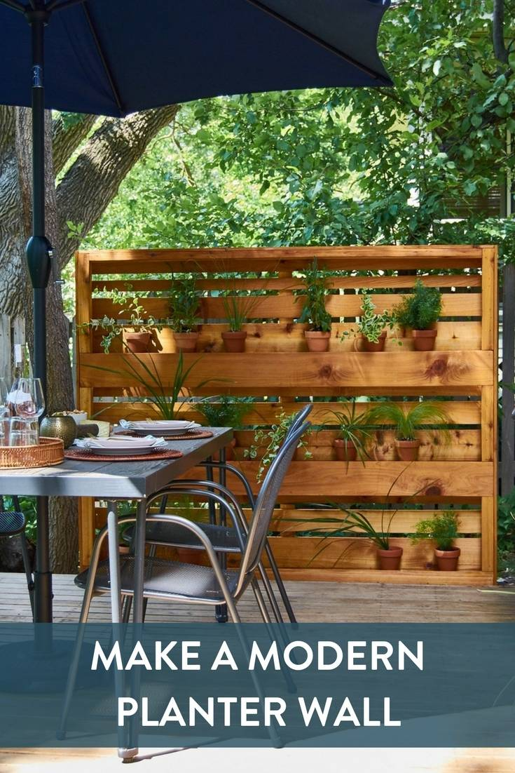 DIY Modern Planter Wall made from cedar fence pickets, with clear acrylic shelves