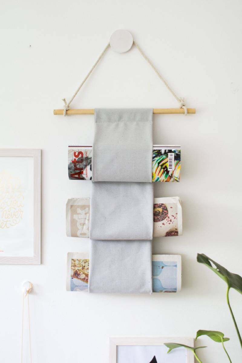 99 ways to use fabric to decorate your home   Hanging magazine holder