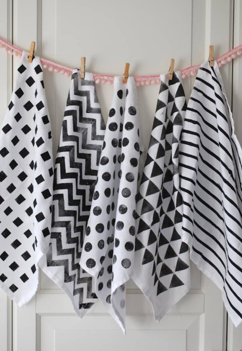 99 ways to use fabric to decorate your home   Stenciled tea towels