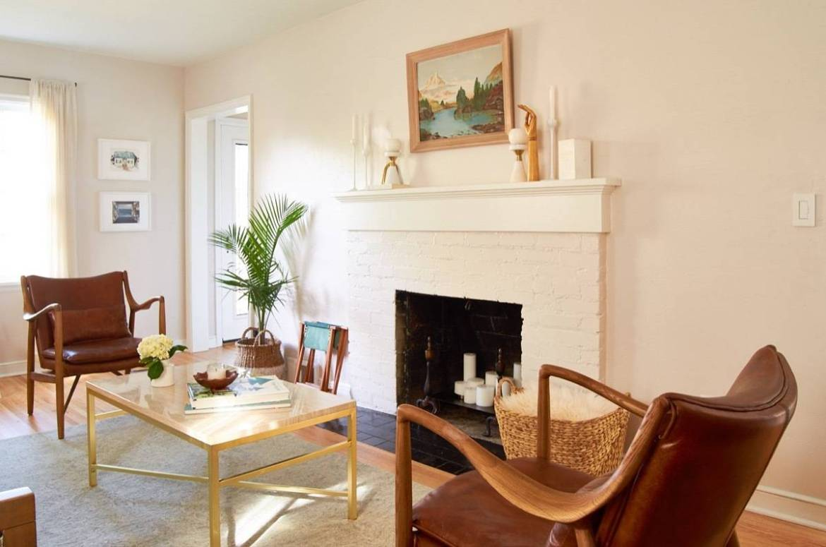 MCM leather chairs with styled fireplace