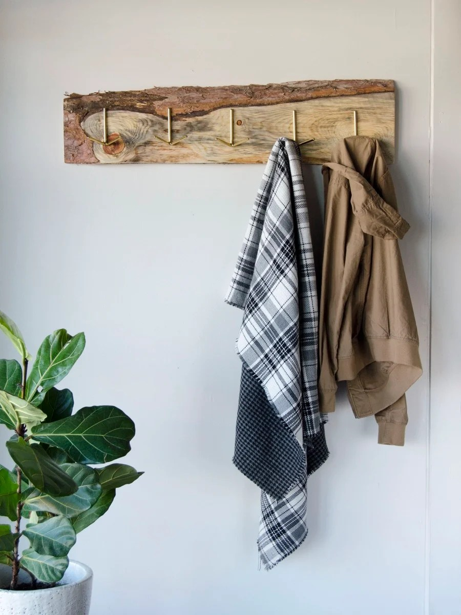 An old wood board gets new life as a rustic DIY coat rack