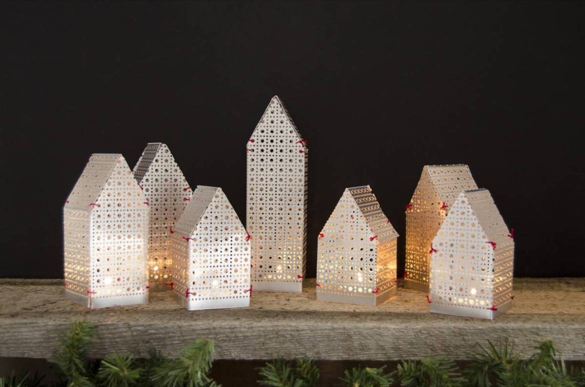 Make these house-shaped luminaries to warm up your mantel