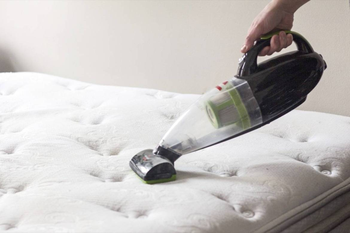 How to Clean your Mattress: Vacuum baking soda to remove moisture