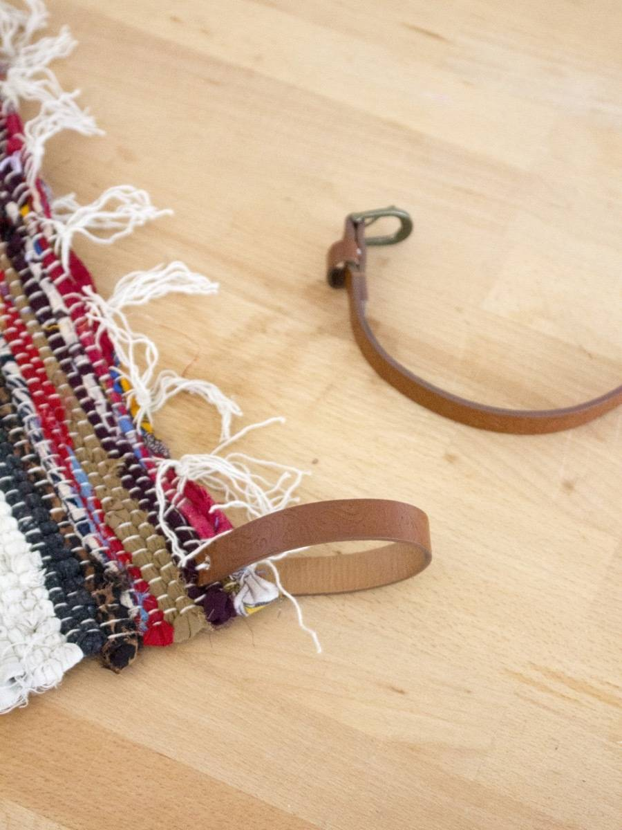 An old belt, plus a rag rug, equals wall art!