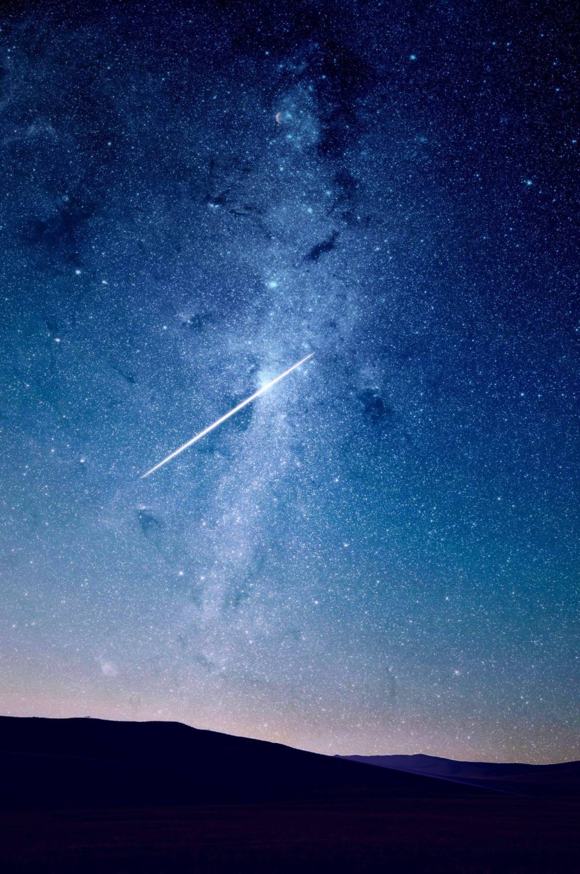 Spotting a meteor in a starry night sky is a summer activity that you should make sure not to miss out on. #summer #stargazing #stars #meteors