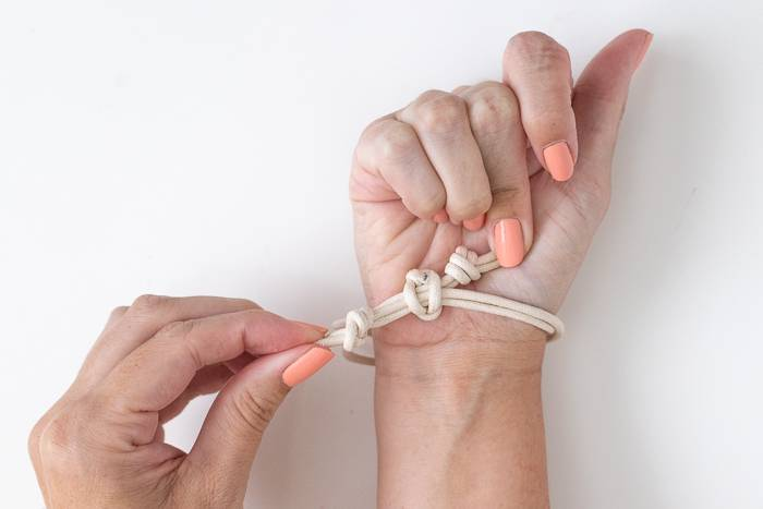 How to put on a DIY knotted bracelet
