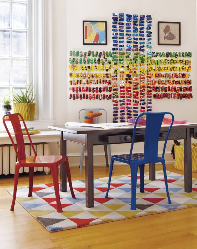 Use magnetic knife strips to create a wall mural out of toy cars