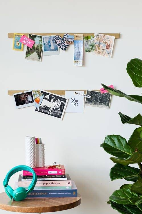 Use a magnetic knife strip to display photos and art