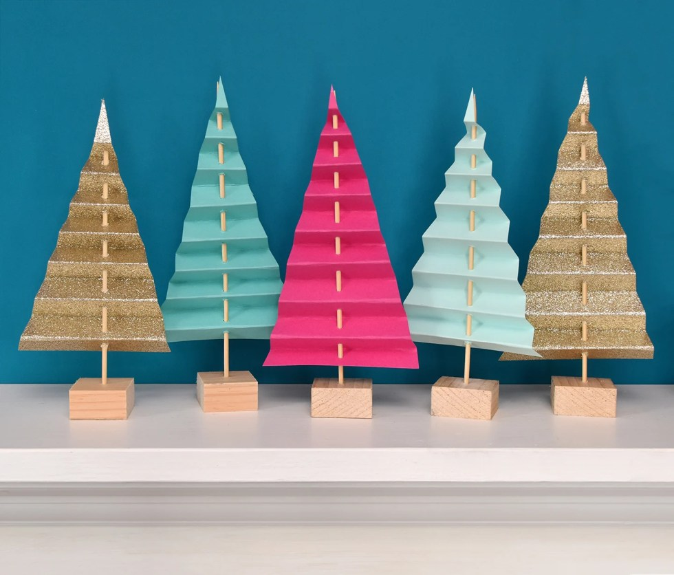 Easy Mantel Idea: Colorful Paper Tree Forest | By Curbly #diy #paper #christmas