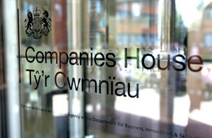 Photograph of Companies House logo on glass door