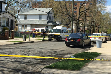 He was shot while sitting in a car outside 114-23 167th St., officials said.
