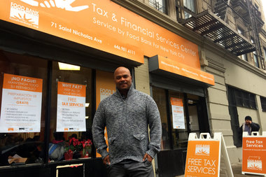 Tejeda, who runs the free tax service program for the Food Bank for New York City, stands in front of their center in Harlem at 71 Saint Nicholas Ave.