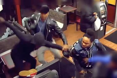 The assault at a Flatbush fast-food restaurant was caught on video, police said.
