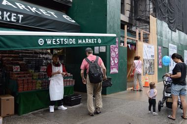 Residents stop by for groceries at West Side Market but also peer into the worrisome construction site next door.