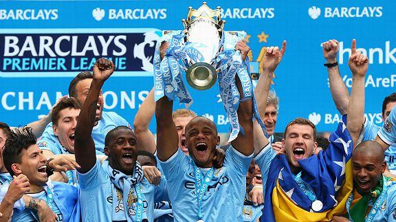 Vincent Kompany lifts the Premier League trophy for a second time.