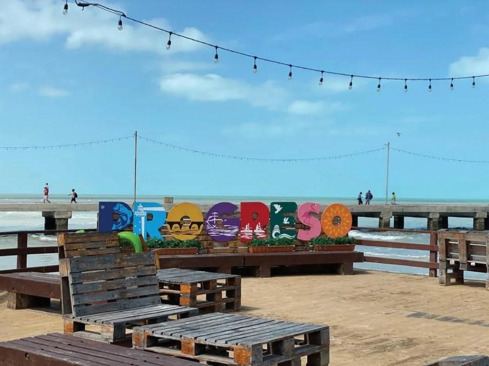 The Sign at Progresso Beach 20 minutes outside of Merida, Yucatan. Photo Credit : Doni Aldine