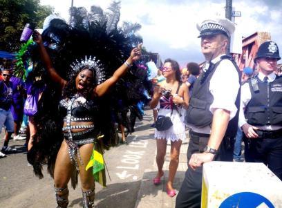 wpid-Notting-Hill-Gate-Carnival-dancer-cop.jpg