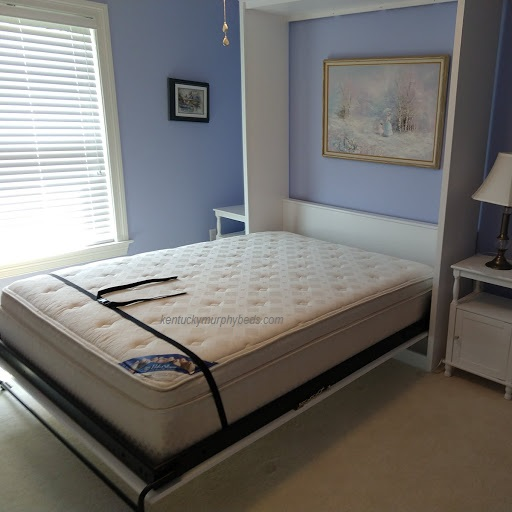 White painted queen panel door Murphy bed with solid wood door and cathedral arch trim, crown molding - open view