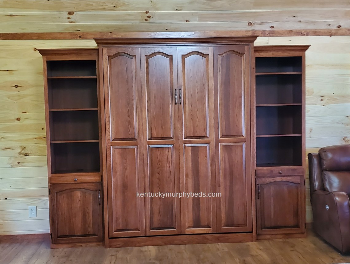 queen size murphy bed with bookcases, in hickory with autumn finish, closed view shown in woodland cottage , May 2020