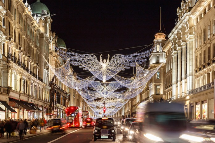 Illuminated angel Christmas lights hanging above Regent Street, London