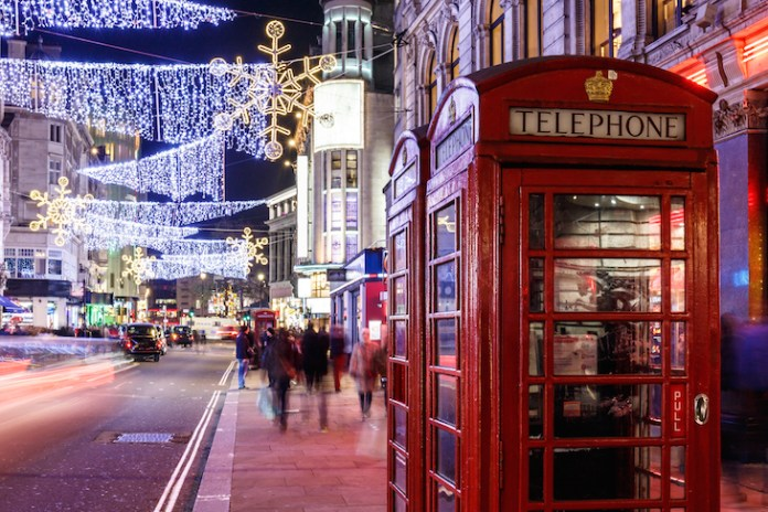 Christmas lights above a red telephone box in Soho, London