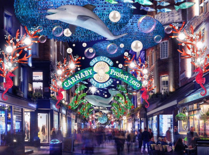 Sea life themed Christmas lights and decorations, including whales, fish and tortoise, hanging over Carnaby Street in London