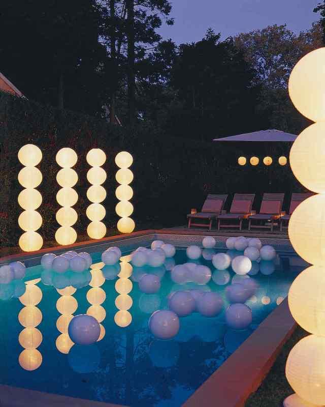 Paper lantern columns by a pool