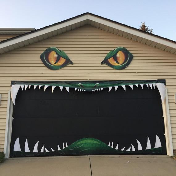 We Can't Stop Watching This Halloween Garage Door in