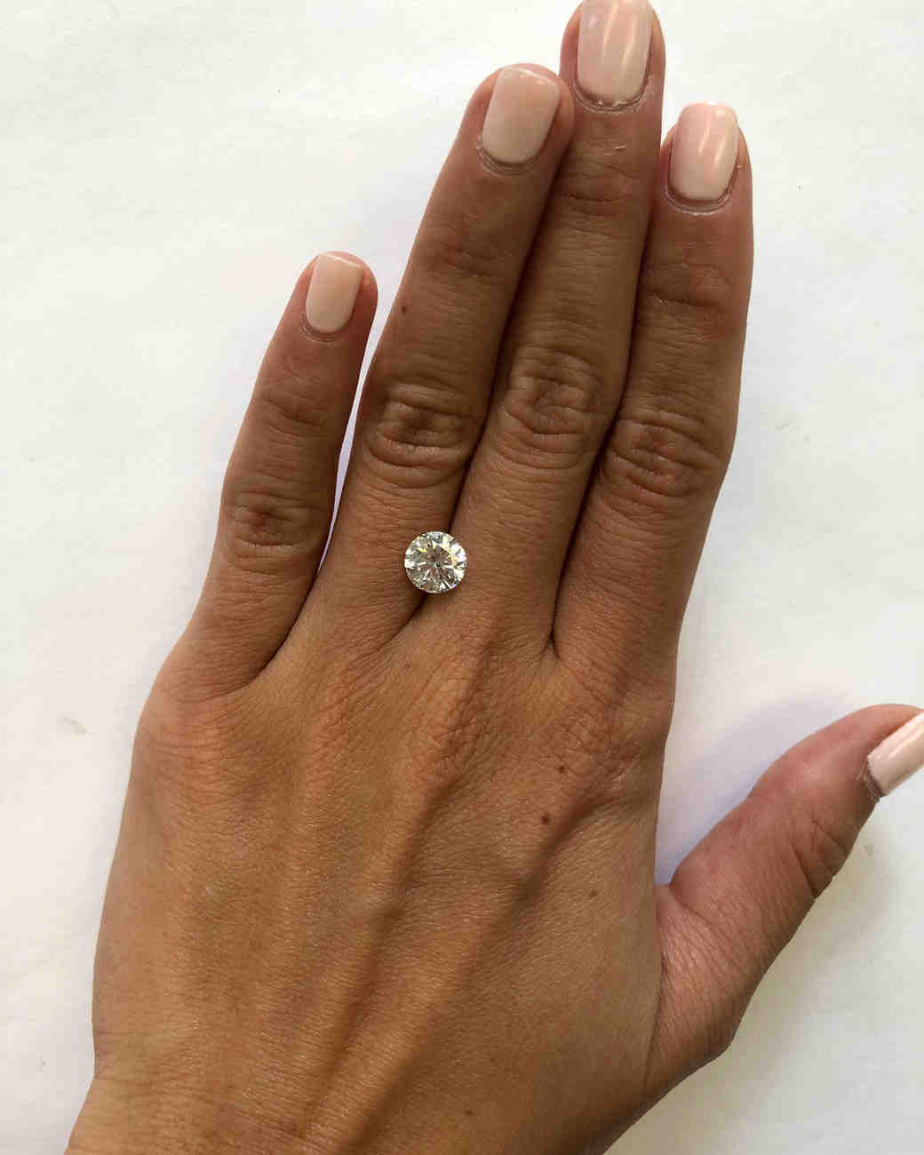 Hand with carat diamond also this is what  looks like at every size  from carats to rh marthastewartweddings
