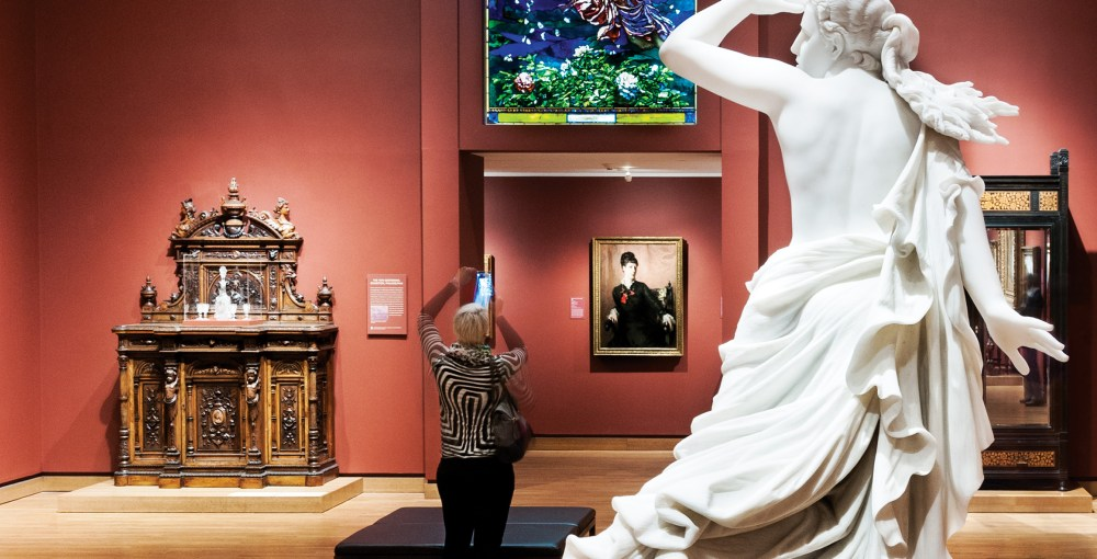 Woman taking a photo in the American Art galleries