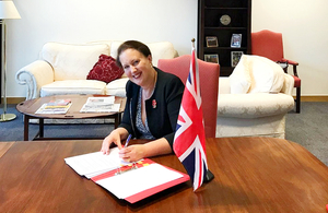Fisheries Minister Victoria Prentis signs the MoU