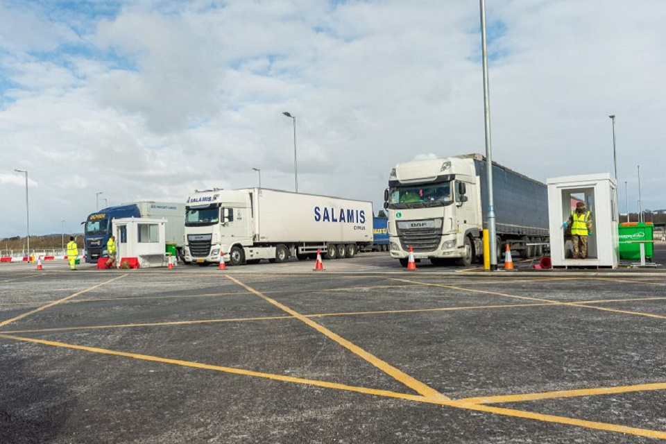 Large lorries are parked in a haulier testing site at Sevington Kent.