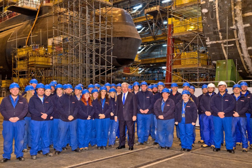 Defence Secretary Sir Michael Fallon with BAE Systems apprentices inside Devonshire Dock Hal. Picture: Michael Vallance, BAE Systems.