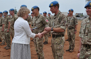 HMA Alison Blackburne presents commander Lt Col Jason Ainley with his UNMISS medal in Juba.