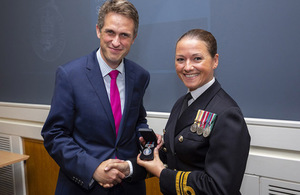 Lt Cdr Lindsey Waudby receives the Operational Service Medal Iraq and Syria from Defence Secretary Gavin Williamson