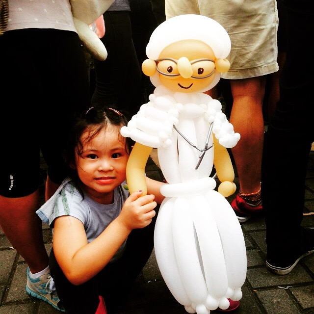 She is Frances, a small girl holding a Pope Francis doll. She promises to hold it up high for the Pope to see when he passes by