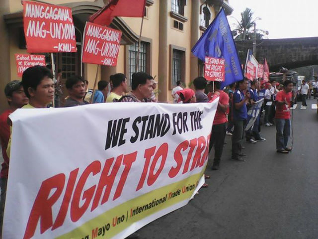 PROTEST. Labor groups protest in front of the labor department during the Global Day of Action for the Right to Strike, February 18 2015. Photo from Kilusang Mayo Uno