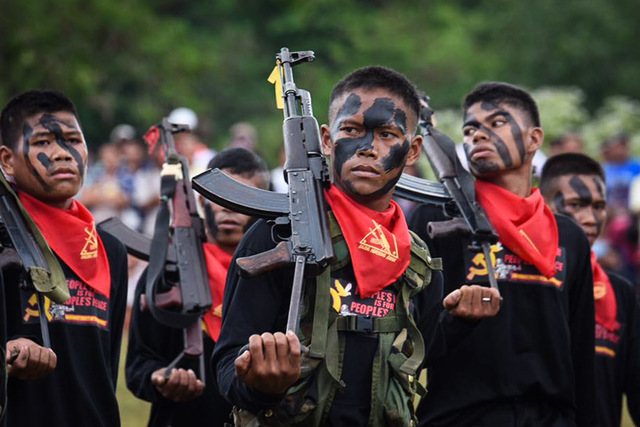 FIVE DECADES. File photo of New People's Army guerrillas marching in Davao City to celebrate the 48th founding anniversary of the Communist Party of the Philippines on December 26, 2016.