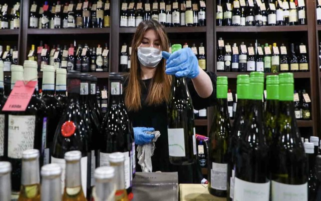 Scotland residents complain police are fining them for leaving home to buy wine, other nonessential items