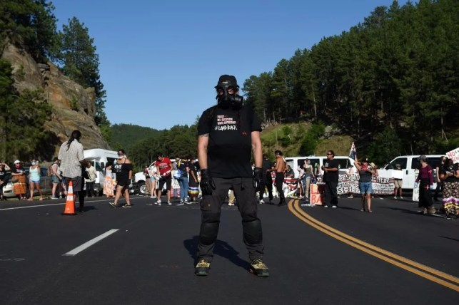 BREAKING: Hundreds of protesters block entrance to Mt. Rushmore ahead of Trump rally, clash with the National Guard