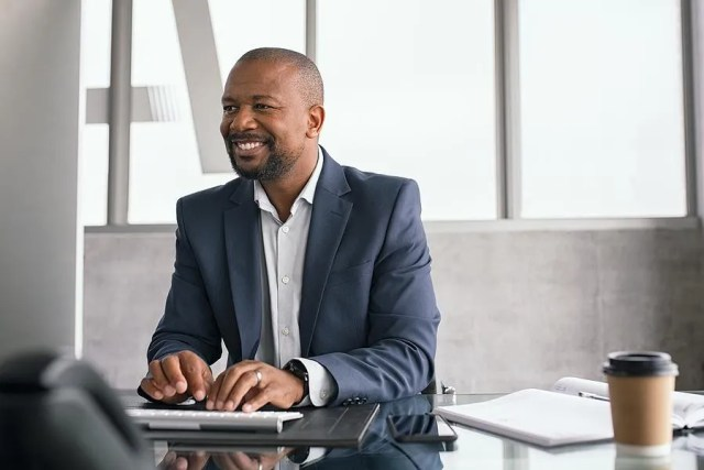 Middle aged man happy at work after changing careers