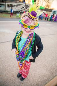 A photo of a young reveler at a Mardi Gras parade in Shreveport.