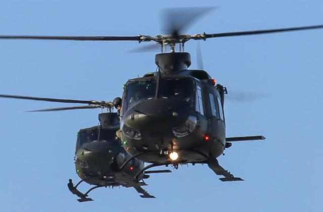 Two 400 Squadron CH-146 Griffon helicopters en route to Toronto's SickKids Hospital to drop off Santa's elves for Operation Ho Ho Ho. Steve Bigg Photo