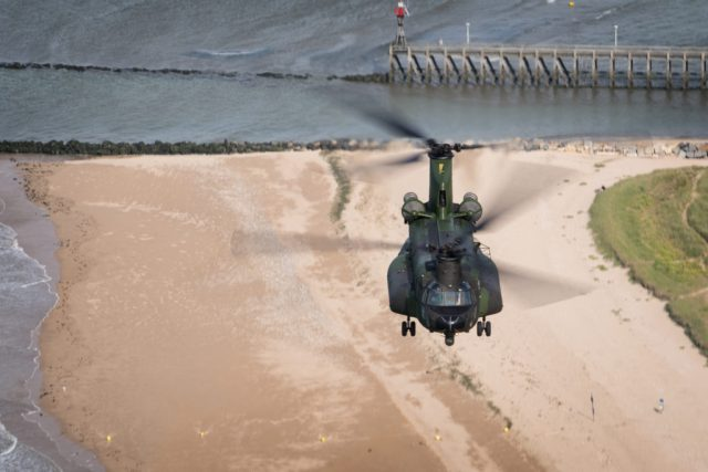 The Chinook continues its flight over the beaches of Normandy, France. Lloyd Horgan Photo