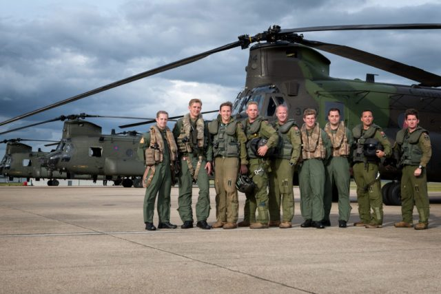 Crews from 18(B) Squadron of the RAF and 450 Tactical Helicopter Squadron pose with their aircraft following a unique sortie over to the Canadian National Vimy Memorial and the D-Day beaches. Lloyd Horgan Photo