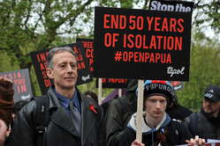 Human rights activist Peter Tatchell joined demonstrators outside the Indonesian embassy in London to call for an end to 50 year of isolation.