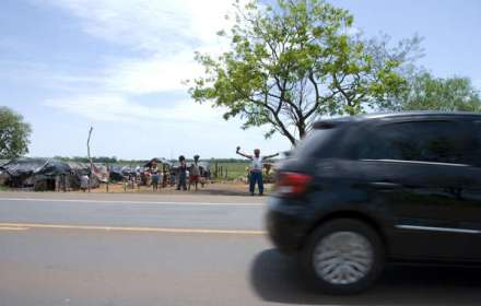 Evictions from their lands for biofuels and cattle ranching has forced the Guarani to live on the road side.