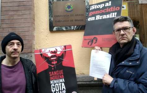 Protesters in Madrid, Spain handing a letter to the Brazilian Embassy, calling for an end to indigenous rights violations.