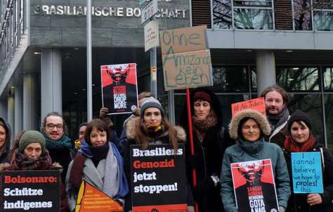Protesters in Berlin, Germany outside the Brazilian Embassy.