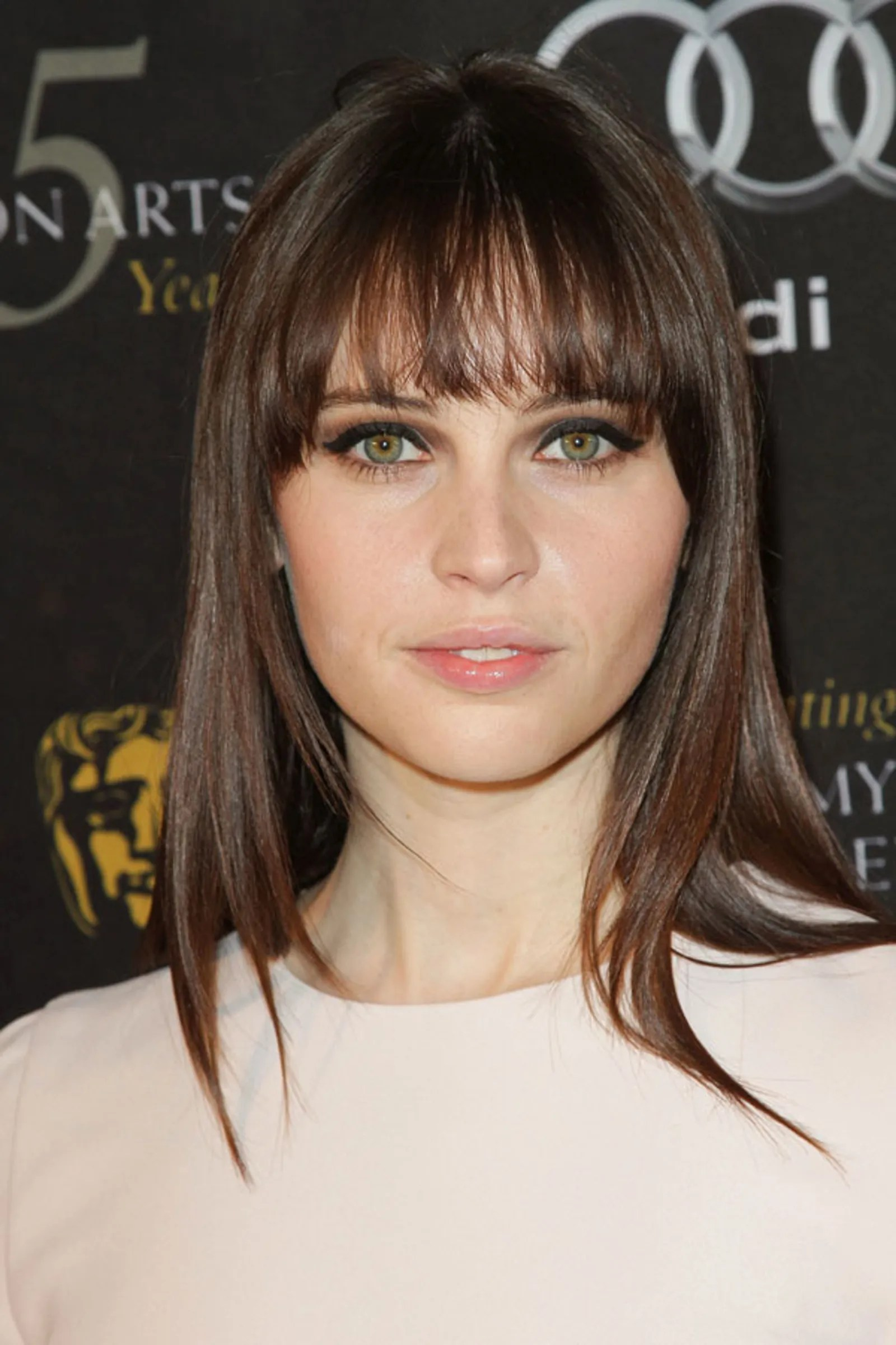 Felicity Jones Reveals her Makeup Skincare and Nail Polish Favorites  Teen Vogue